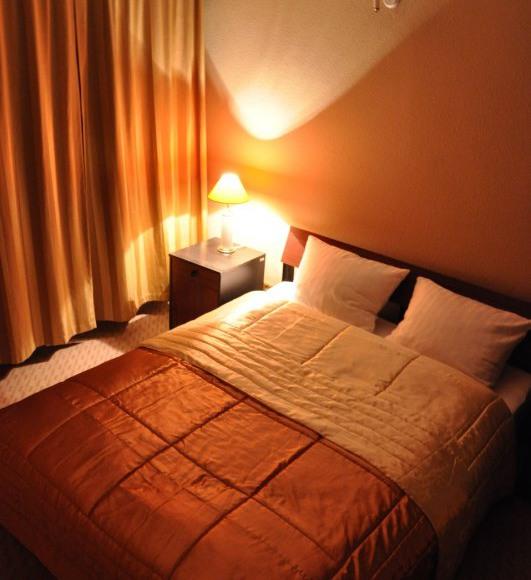 sypialnia pokoju o podwyższonym standardzie