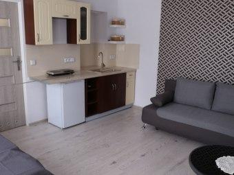 Pokoje / apartamenty z aneksami kuchennymi
